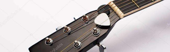 depositphotos_347767626-stock-photo-close-view-guitar-picks-strings.jpg