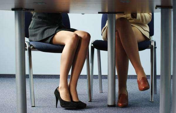 depositphotos_3244288-stock-photo-legs-of-women-under-table.jpg