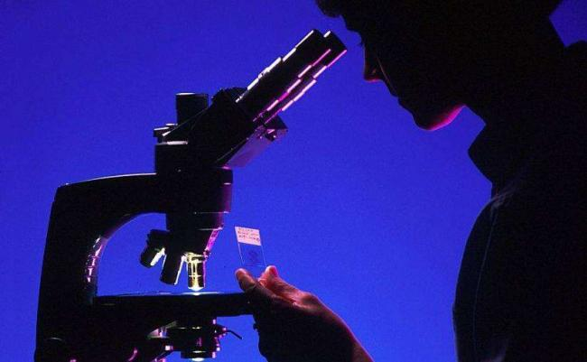 scientist-with-microscope-996187-edited-825x510.jpg